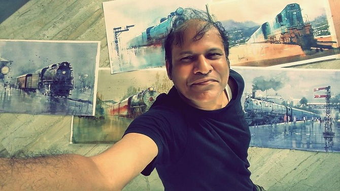 Bijay Biswaal with his paintings