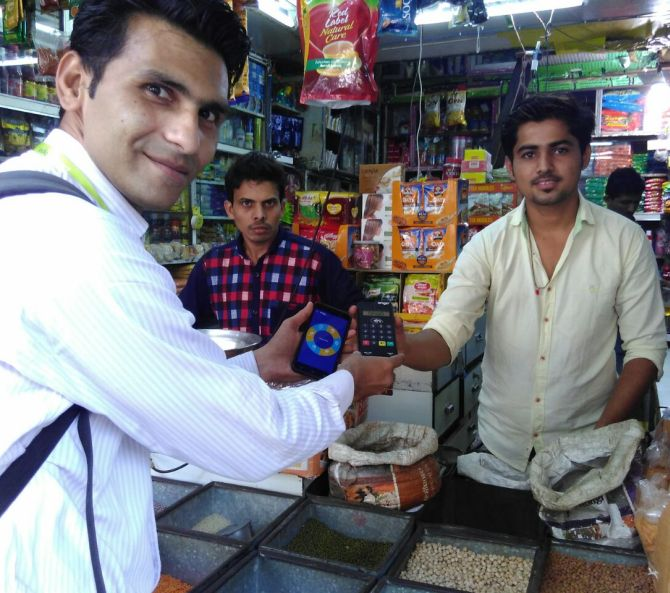 The foot soldiers of Modi's cashless India