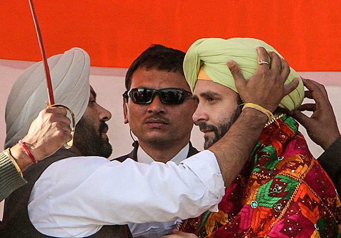 Rahul Gandhi is presented with a turban by his party supporters during a campaign rally ahead of state assembly elections at Sirhind in 2012.