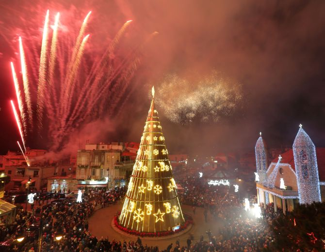 Fireworks are set off as a Christmas tree is illuminated in Dhour Shweir, Mount Lebanon. Photograph: Aziz Taher/Reuters