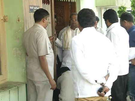 Karnataka CM in hot water after video of man tying his laces goes