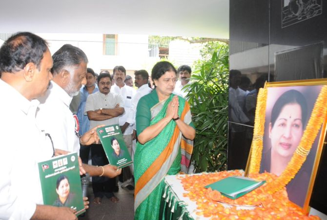 V K Sasikala, right, O Panneerselvam, centre, and M Thambidurai, left