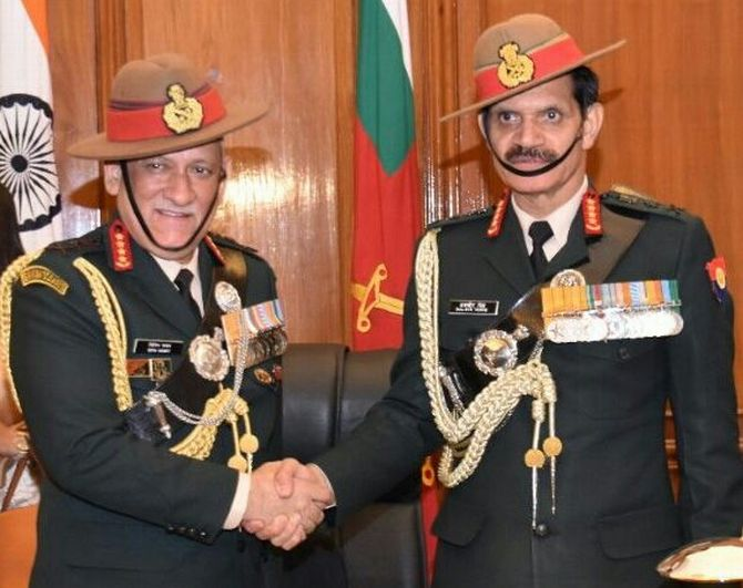 General Bipin Rawat, left, the new army chief, with General Dalbir Singh Suhag.
