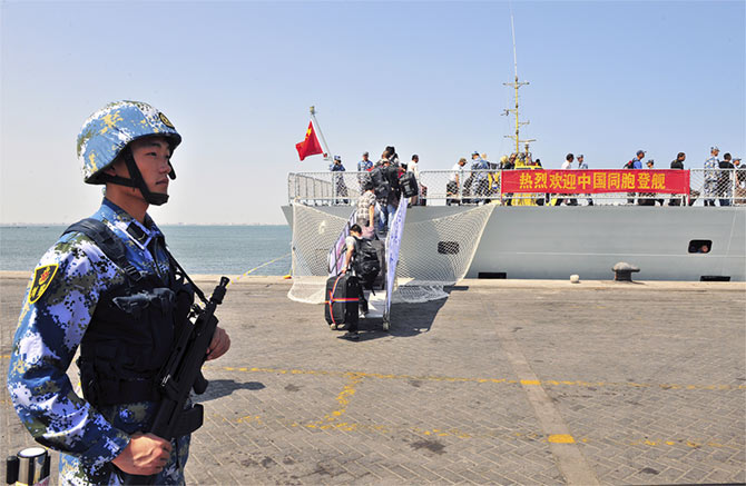 Chinese citizens from Yemen board the naval ship <em>Linyi</em> at a port in Aden, March 29, 2015.  They were transported across the Red Sea to Djibouti to be flown home. Photograph: Reuters
