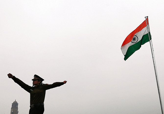 A soldier marches past the national flag in New Delhi. Photograph: Adnan Abidi/Reuters
