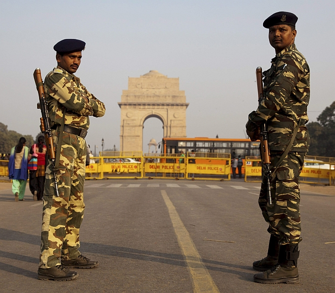 Troopers guard the India Gate in New Delhi ahead of Republic Day.