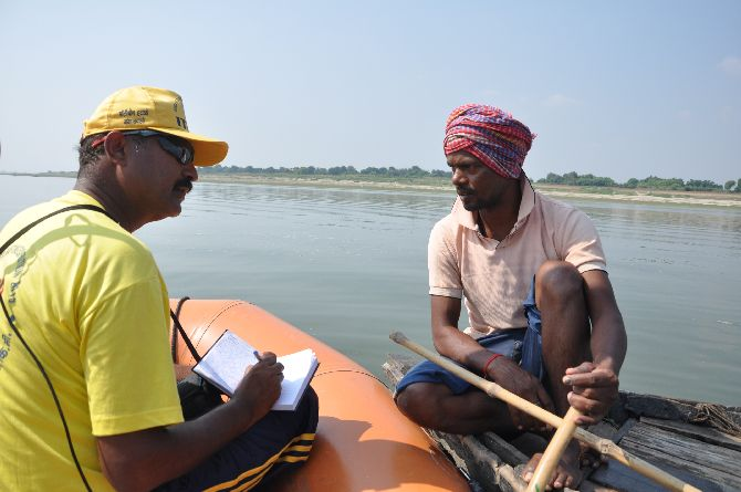 Surinder Khatri speaks  to a fisherman