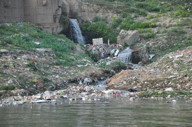 Sewage and effluents flow unchecked into the river