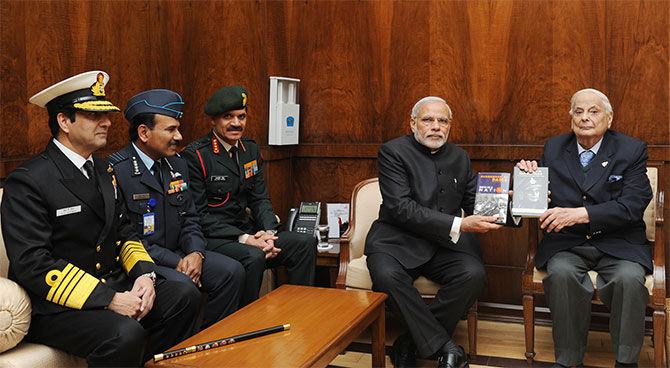 General J F R Jacob presents his books to Prime Minister Narendra Modi with the three service chiefs, Admiral Robin Dhawan, Air Chief Marshal Arup Raha and General Dalbir Singh, December 16, 2014. Photograph: Press Information Bureau