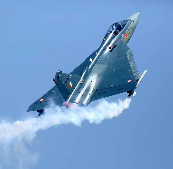 A Tejas aircraft, the fourth plus generation lightweight, multi-role supersonic single engine jet sporting the IAF colours, soars to the skies, July 1, 2016. Photograph: PTI