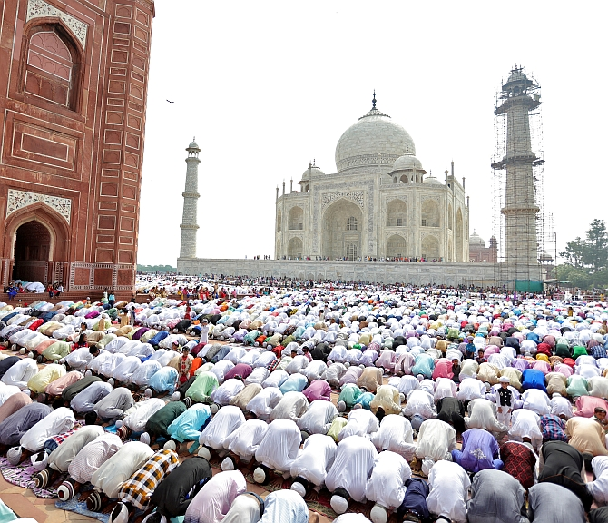 Muslims attend Eid al-Fitr prayers at the Taj Mahal mosque in Agra. Photograph: Pawan Kumar/Reuters