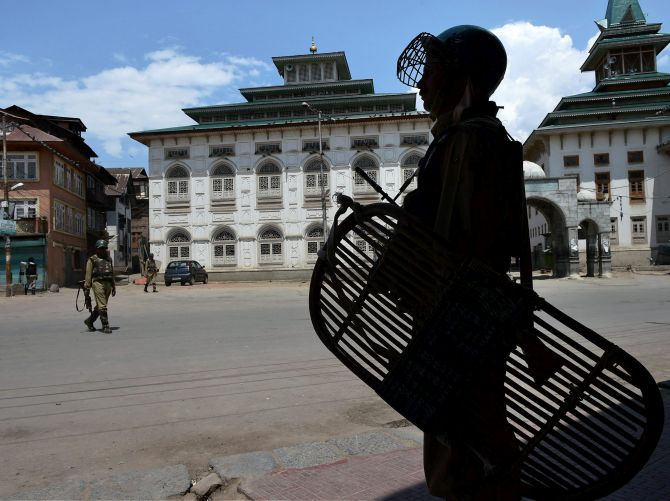 Security personnel on a deserted Srinagar street. Photograph: Umar Ganie