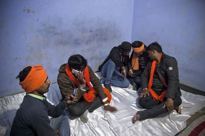 Gau rakshaks get tip-offs about possible cow smugglers in the area on their mobile phones. Photograph: Allison Joyce/Getty Images