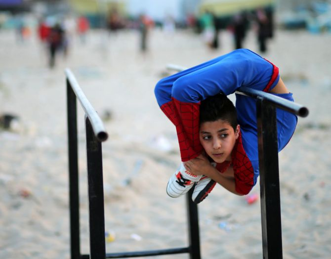 India News - Latest World & Political News - Current News Headlines in India - PHOTOS: This Gaza boy twists and turns his body like no other