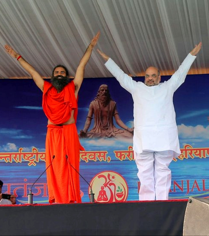 India News - Latest World & Political News - Current News Headlines in India - PIX: Amit Shah, Smriti, Rajnath roll out yoga mats