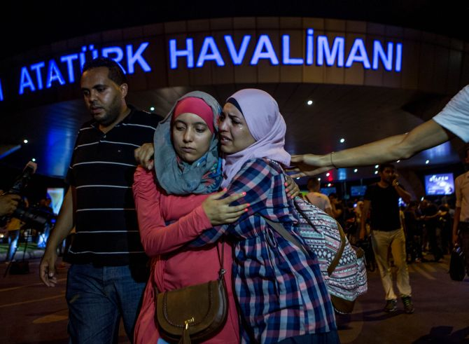 IMAGE: Passengers leave Istanbul Ataturk, Turkey's largest airport, after a suicide bomb attack. Photograph: Defne Karadeniz/Getty Images