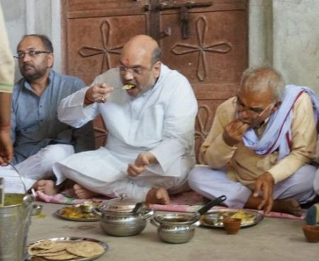 Bharatiya Janata Party President Amit Shah had a meal with a Dalit family in Jogiyapur village in the Sevapuri assembly segment in Prime Minister Narendra Modi's Varanasi Lok Sabha constituency, June 2016.