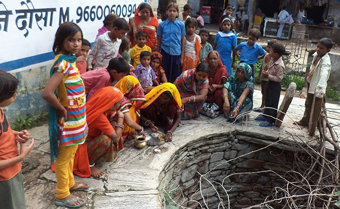 A kuwa puja (worshipping the well) ceremony takes place to celebrate the birth of a girl child in Dausa, Rajasthan.