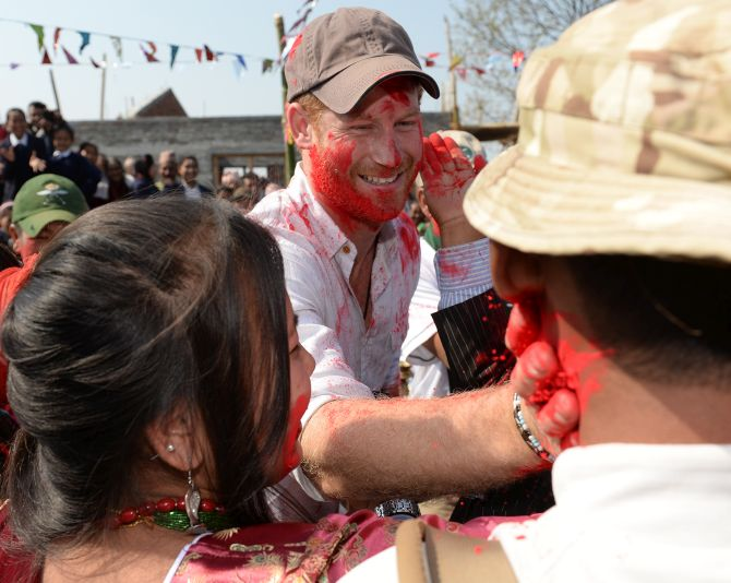 India News - Latest World & Political News - Current News Headlines in India - PHOTOS: Britain's Prince Harry sees red during Holi in Nepal