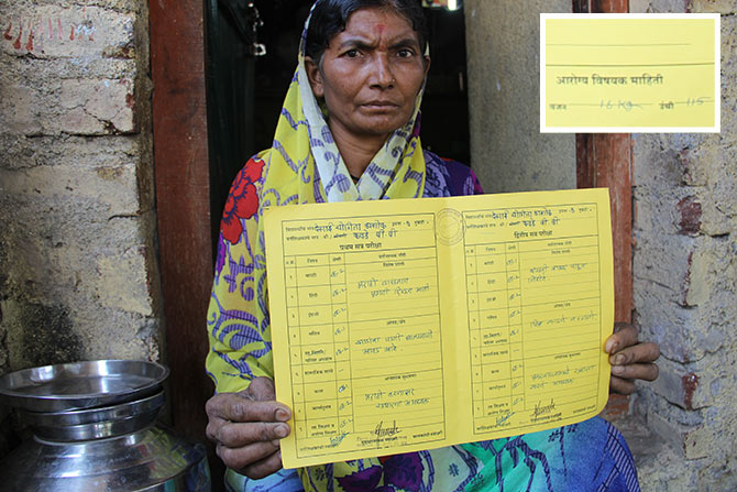 Yogita's aunt shows her report card. Her father couldn't control her emotions as he saw the report card again.