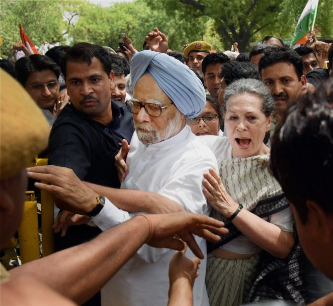 Congress President Sonia Gandhi and former prime minister Dr Manmohan Singh court arrest during the 'Save Democracy' march in New Delhi, May 6, 2016. Photograph: Shirish Shete/PTI Photo
