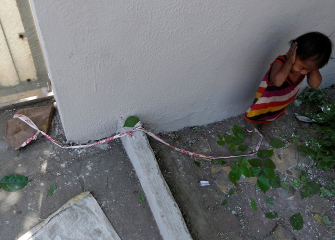 India News - Latest World & Political News - Current News Headlines in India - PHOTOS: 15-month-old is tied to a rock while parents work
