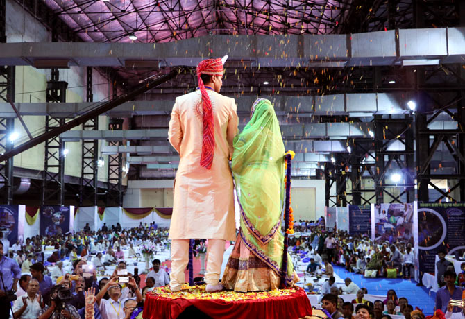The first couple to get married seek blessings from the crowd.