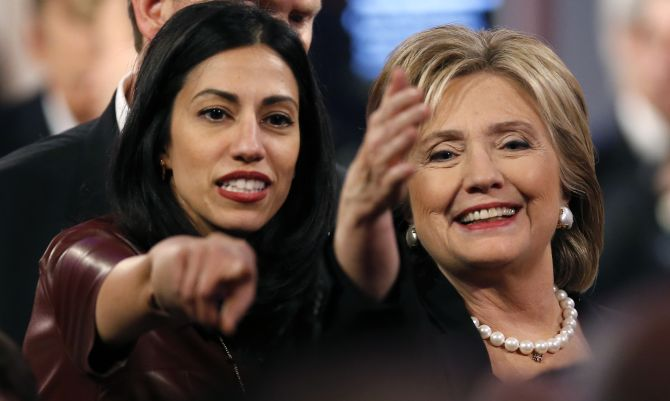 Huma Abedin with Hillary Clinton at the second Democratic presidential candidates debate in Des Moines, Iowa, November 14, 2015. Photograph: Jim Young/Reuters