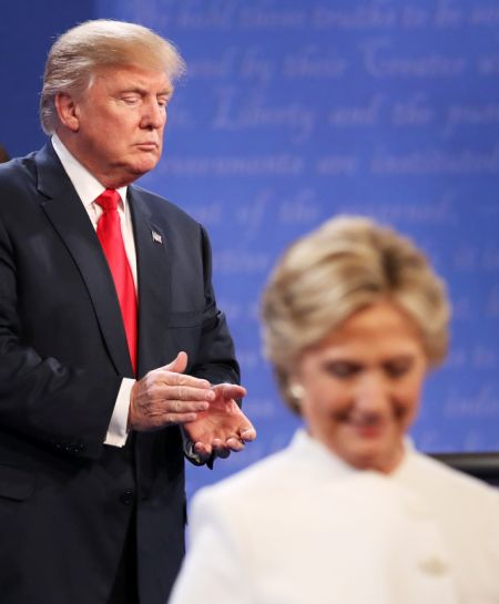 Democratic presidential nominee Hillary Clinton walks off stage as Republican Donald Trump looks on during the third US presidential debate in Las Vegas. Photograph: Drew Angerer/Getty Images