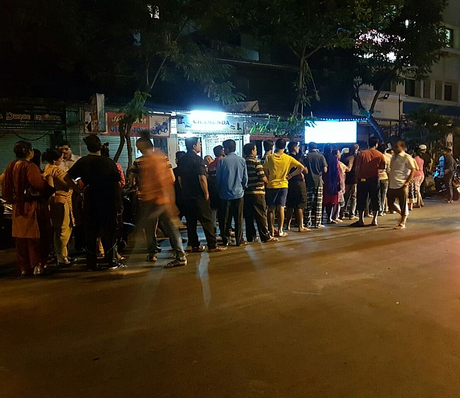 : People queue up outside an ATM in Mumbai. Photograph: Vedant Kotian for <em>Rediff.com</em>
