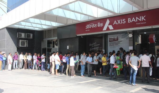 People queue up for money outside a bank