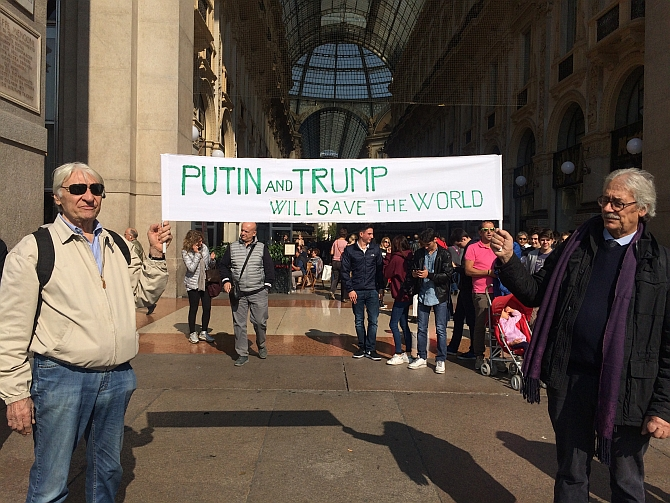Vladimir Putin and Donald Trump supporters in Milan, Italy. Photograph: Vittorio Zunino Celotto/Getty Images