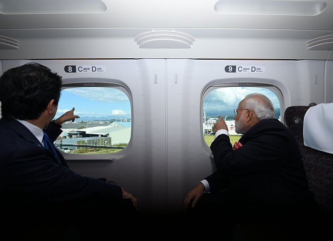 November 2016: Modi and Abe aboard Japan's high-speed Shinkansen bullet train.