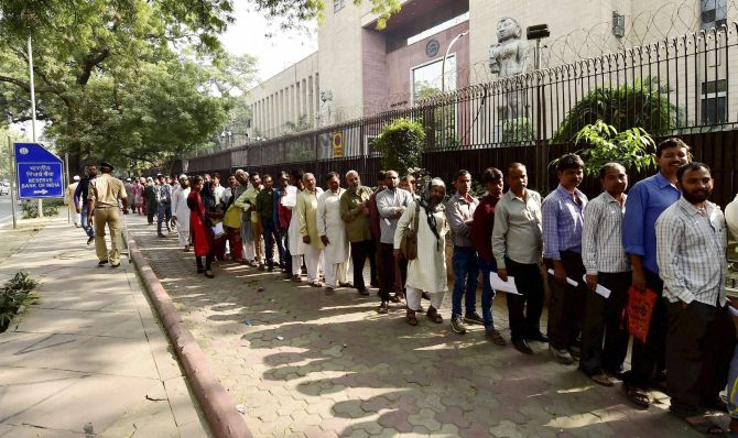 Indians wait in a long queue outside the Reserve Bank of India in New Delhi, November 13, 2016. Photograph: Kamal Singh/PTI Photo