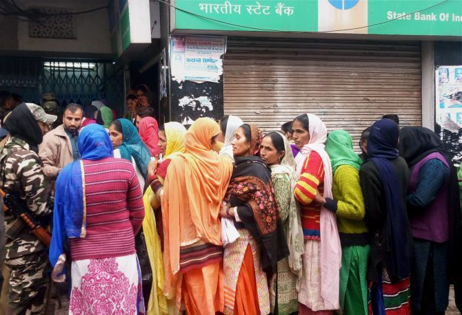 RAJOURI: A queue outside the State Bank of India. Photograph: PTI Photo