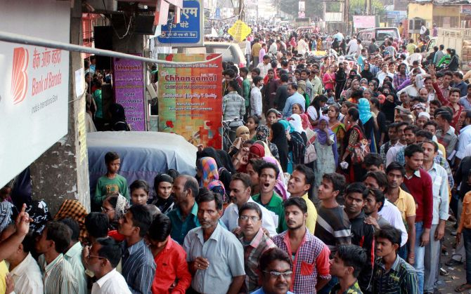 LUCKNOW: People queue up outside a bank. Photograph: Nand Kumar/PTI Photo