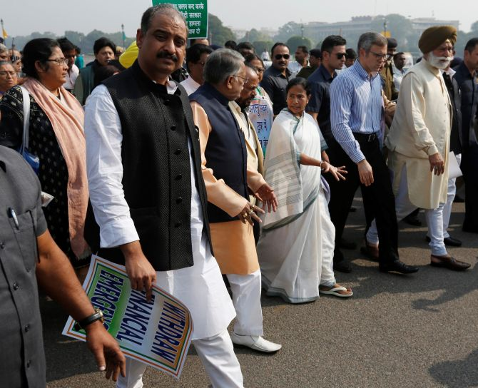 IMAGE: West Bengal Chief Minister Mamata Banerjee leads a march to Rashtrapati Bhavan to protest against demonestisation. Photograph: PTI Photo