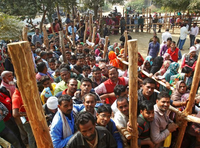 Villagers queue outside a bank on the outskirts of Allahabad. Photograph: Jitendra Prakash/Reuters