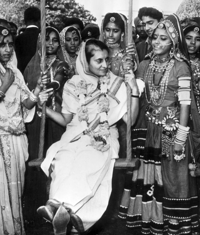 Indira Gandhi surrounded by folk dancers from Rajasthan at her home in New Delhi in 1967. Photograph: Express/Getty Images