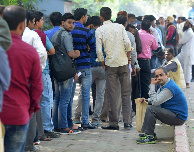 People wait in a long queue to deposit Rs 500 and Rs 1,000 currency notes outside the RBI in New Delhi. Photograph: Manvender Vashist/PTI Photo