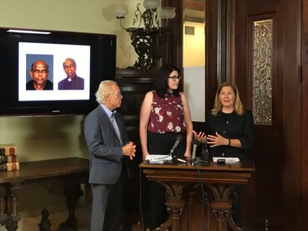 Abuse victim Megan Peterson, centre, at a press conference in Minnesota. On the blackboard are images of the accused Joseph Jeyapaul