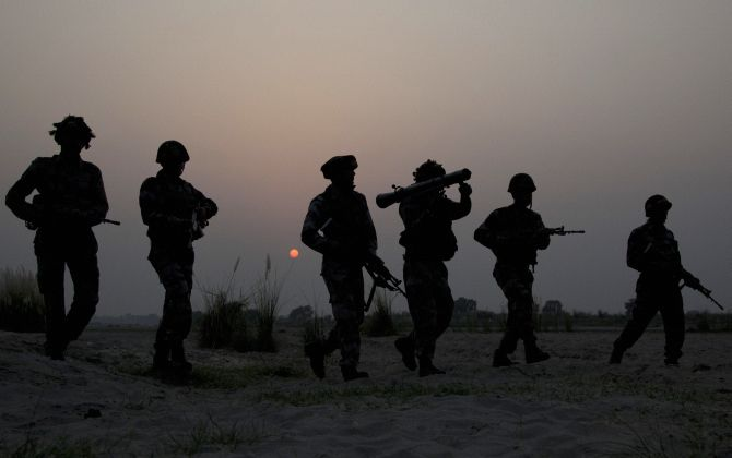 Soldiers patrol the LoC