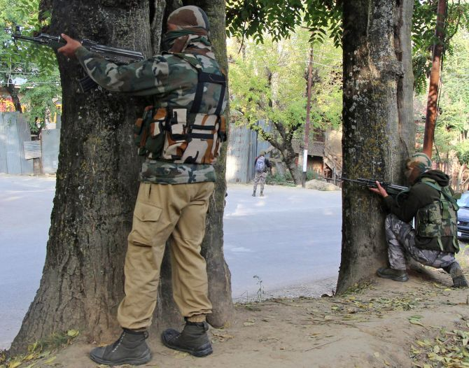 Troops take positions to neutralise terrorists at Langate, Kashmir, last October. Photograph: Umar Ganie