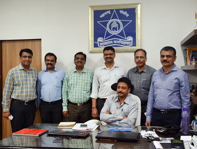 Senior police inspector, Unit 1, Nitin Thakare (extreme right in blue shirt), Assistant Commissioner of Police (Detection) Mukund Hatote (seated) along with members of the Thane Crime Branch team that busted the scam