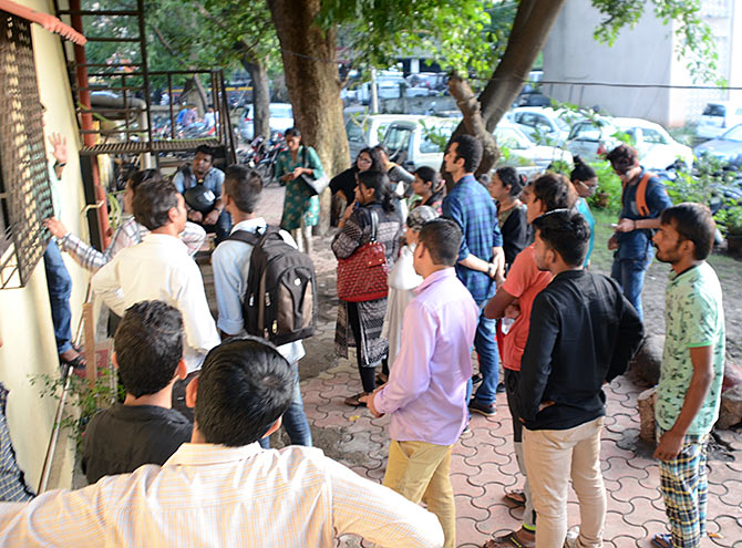 Employees of the Delta IT Park call centre waiting for questioning outside the Thane Crime Branch office for their turn. While 70 people have been arrested the rest were released after being asked to present themselves for questioning as and when required.