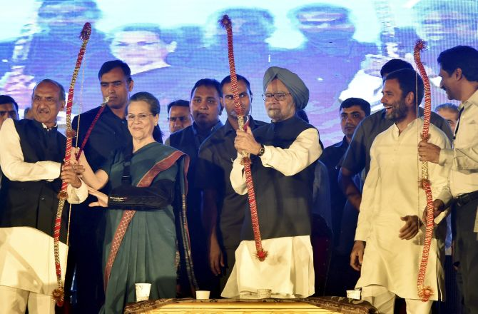Congress President Sonia Gandhi, former PM Manmohan Singh and Congress vice-president Rahul Gandhi at the Nav Shri Dharmic Leela Committee's Dussehra celebrations at the Red Fort Ground in New Delhi, October 11, 2016. Photograph: Kamal Singh/PTI Photo