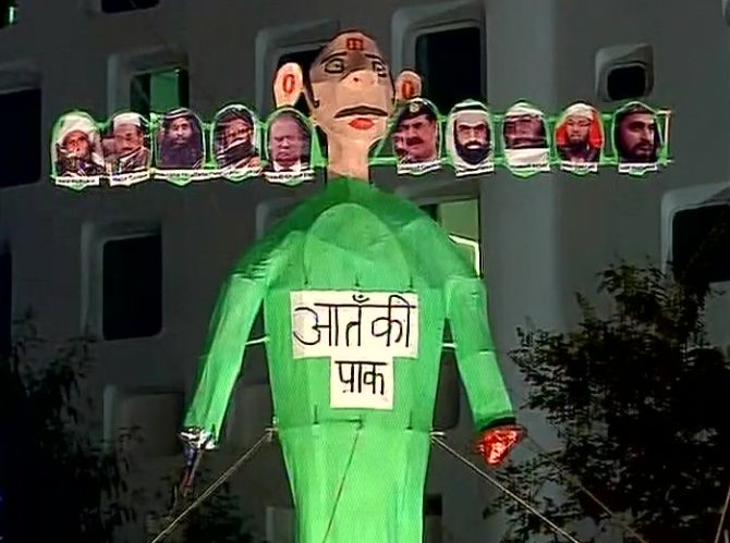 Ravan's effigy at the IP Extension in New Delhi with photographs of Pakistan PM Nawaz Sharif, army chief General Raheel Sharif, Lashkar-e-Tayiba terrorist Muhammed Saeed and other terrorists. The text reads, 'Aatanki Pak (terrorist Pakistan).'  Photograph: ANI