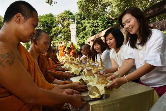 Thai devotees offer prayers with relics of Lord Buddha at Mahabodhi Temple in Bodh Gaya