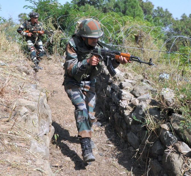Indian soldiers on a search operation near the Line of Control in Jammu and Kashmir