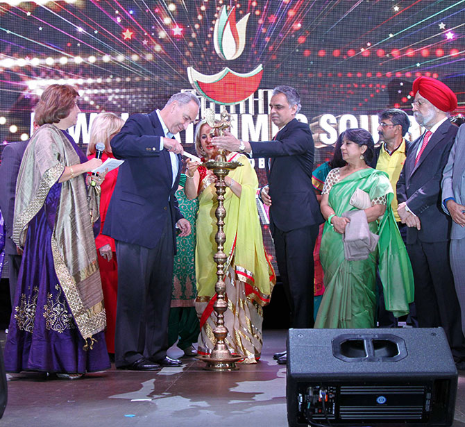US Senator Chuck Schumer lights the lamp with some assistance from Ambassador Syed Akbaruddin, India's permanent representative to the United Nations, Diwali@Times Square, New York, October 16, 2016.